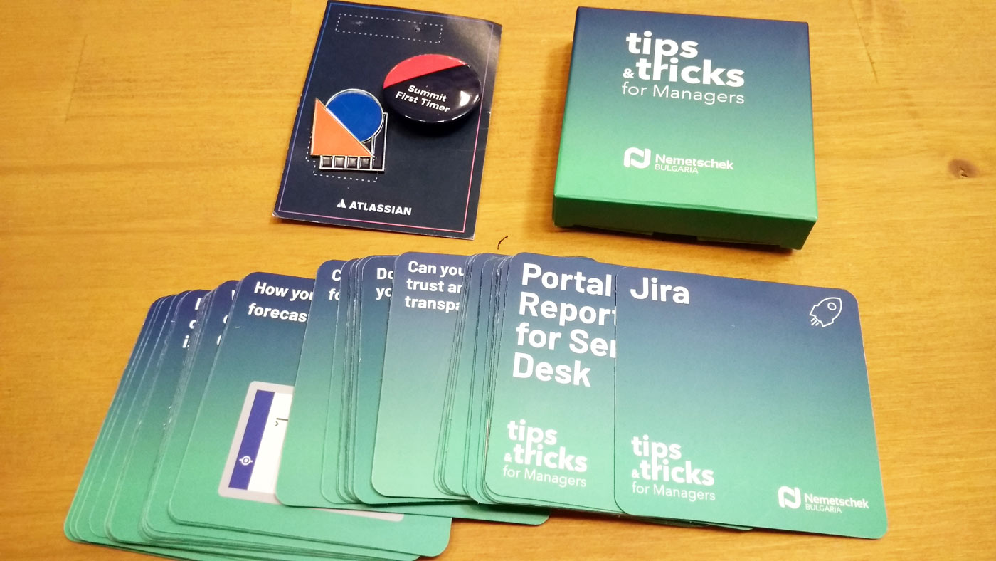 Atlassian summit swags: first timer badge, project manager's cards